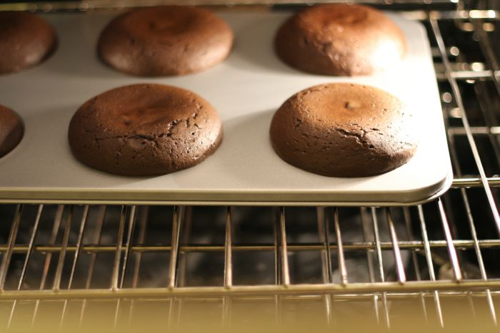 Chocolate Muffin Tops in oven