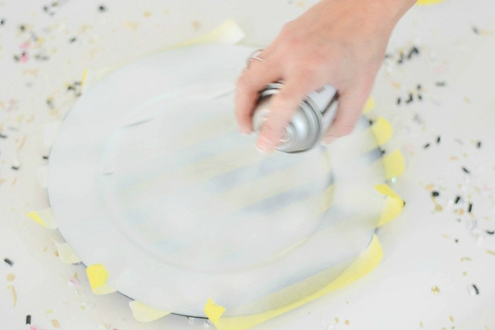 Black Plastic Plate being sprayed with paint