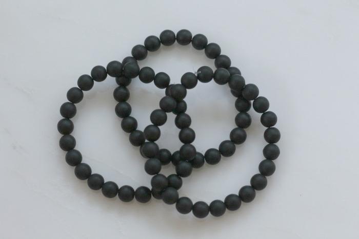 Three black bead bracelets