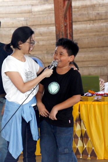 A young boy answering questions on protecting the Coral Triangle