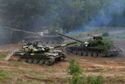 Ukrainian T-64 tanks are seen during during a military exercise for Ukrainian army reservists at a shooting range near the village of Goncharivske in Chernihiv region