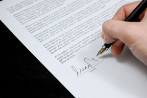 Image of a document being signed