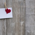 Notecard with a heart on a string