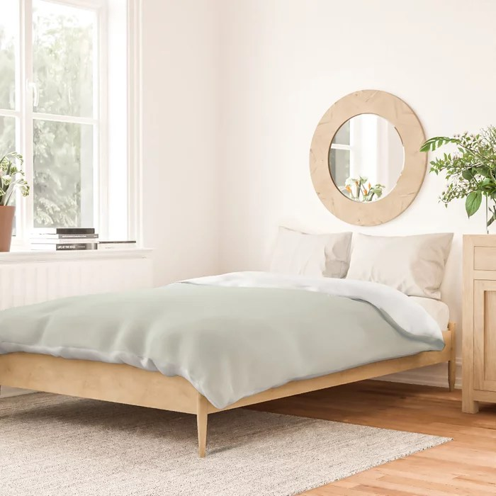 Pastel Green Solid Color duvet cover Pairs Behr 2022 Color of the Year Breezeway MQ3-21. 2022 color scheme, trending interior design hue.