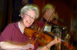 June Ingram, of Mystic, plays the fiddle with Marty Swiatek & RBO polka band Sunday June 6