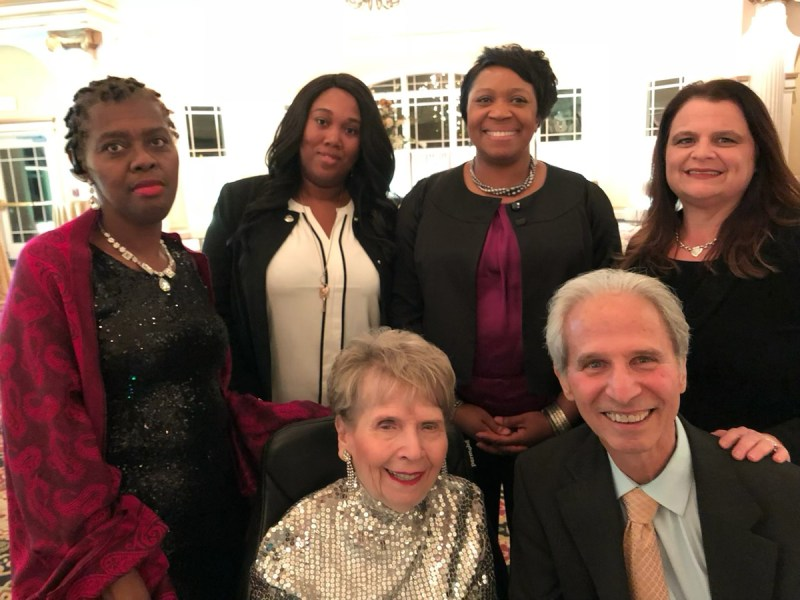 Image of Lynne Gillette (front, in sequins) at the Greater Hartford Association of Realtors holiday party in 2017. She is pictured with several people who worked with her at the time. (Contributed photo / All rights reserved)