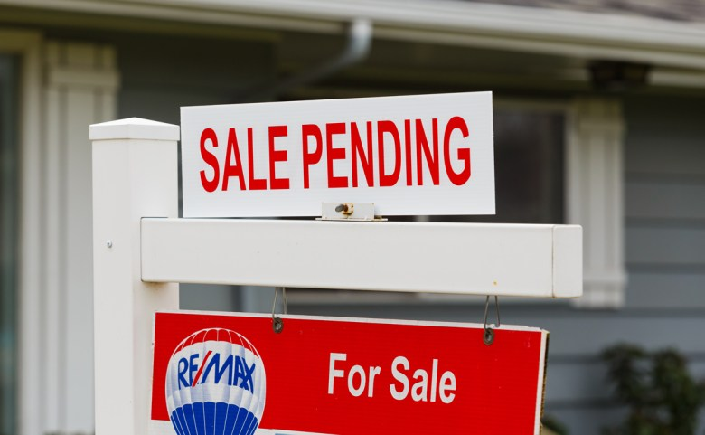 SPRINGFIELD, OR - FEBRUARY 16, 2016: ReMax Integrity listing with a for sale sign is now pending as the real estate market picks up again and prices go up. (Joshua Rainey Photography via Shutterstock)