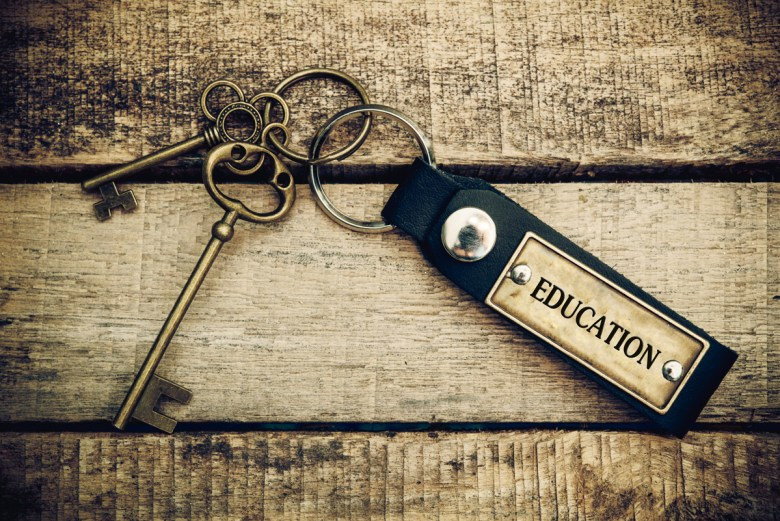 Image of a concept of education is translated by key and silver key chain. (Moomsabuy via Shutterstock)
