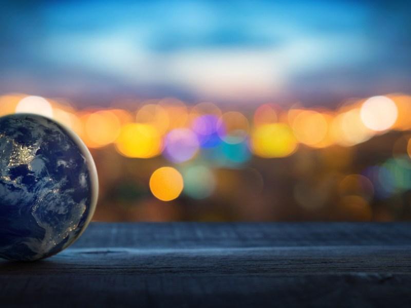 World on blurry light background, politics and economics concept