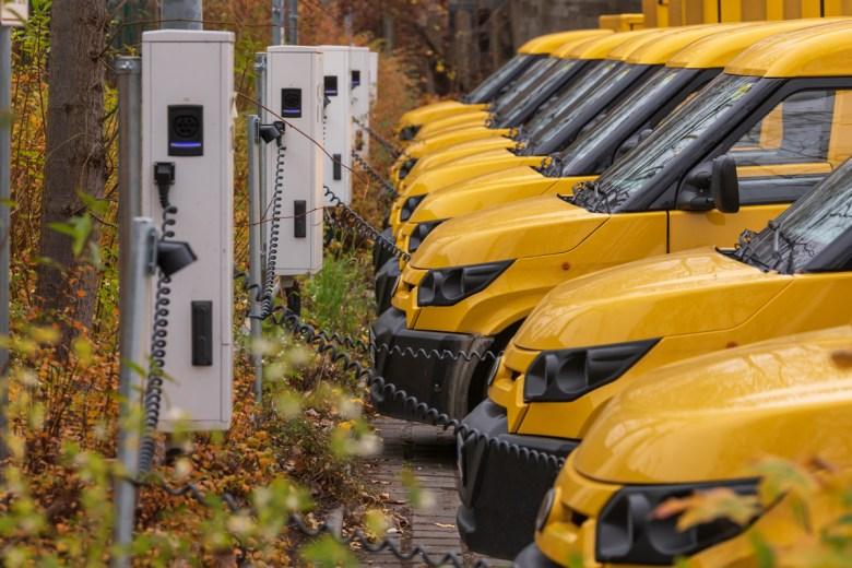 Yellow electric vehicles at the charging station (Ronald Rampsch via Shutterstock)