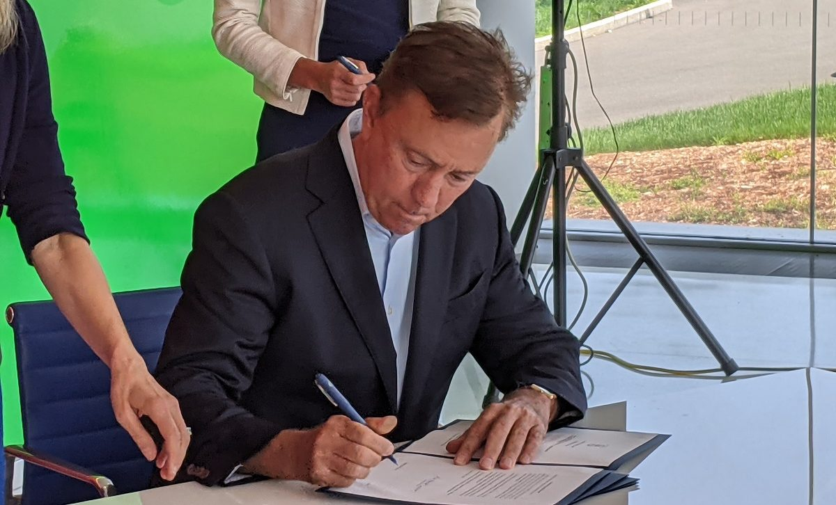 Ned Lamont at ceremonial bill signing on cyber security
