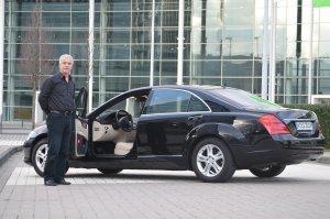 driver with luxury sedan ct