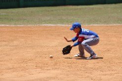 Fielding a ball at first base.