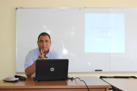 Evian Guerra, a well-known Cuban sports broadcast journalists, presents a lecture on Cuban baseball history to the Vermont team at the Jose Marti Center.