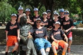 The Vermont team poses with a statue of John Lennon in Havana's Lennon Park.