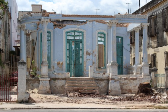 A crumbling piece of historic architecture across the street from Havana's Lennon Park.