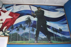 A painting of Cuban leader Fidel Castro playing baseball at the Estadio Latinoamericano.