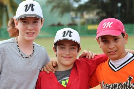 From left to right: Tate Agnew and Cyrus Perkinson, Vermont players, with a player from the Cuban team Marianao.