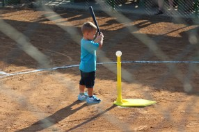 The grandson of Jesus Gutierrez, a Cuban Baseball Federation official, hits a ball before the game.