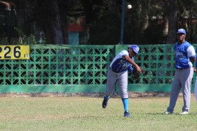 A player from La Habana makes a throw to home plate during the skills competition.