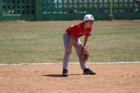 Will Gumbrell looks on at the batter while playing second base.