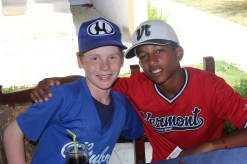 Eli Bostwick (left) poses for a photo with a player from the the Havana provincial team during the postgame lunch.
