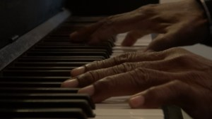 Composer fingers on my piano.