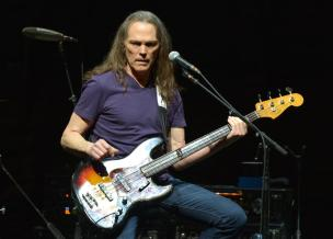 "Timothy B. Schmit of The Eagles performs on the ""History of the Eagles"" tour at the Forum, on Wednesday, Jan. 15, 2014 in Los Angeles. (Photo by John Shearer/Invision/AP)"
