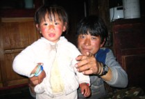 bhutan-bumthang-by-lindsey-weaver-my-bhutanese-host-brother-with-his-daughter-jampay-2006