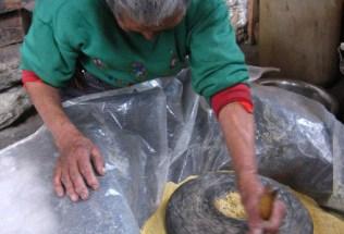 bhutan-bumthang-by-lindsey-weaver-tibetan-woman-grinding-corn-2006