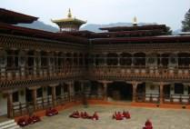 bhutan-by-lindsey-weaver-monks-studying-in-monastery-courtyard-2006