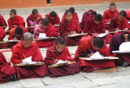 bhutan-by-lindsey-weaver-young-monks-studying-2006