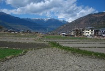 bhutan-paro-by-lindsey-weaver-fields-and-mountain-view-outside-of-paro-2006