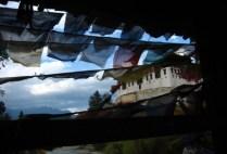 bhutan-paro-by-lindsey-weaver-prayer-flags-and-paro-dzong-fortress-2006