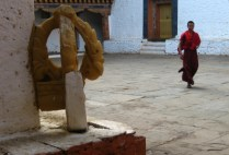 bhutan-punakha-by-lindsey-weaver-monk-walking-through-the-courtyard-at-the-punakha-dzong-2006