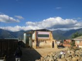 boliviags_by-lex-mobley-building-with-mountains-2013