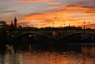 spain-seville-by-meredith-barlow-sunset-over-rio-guadalquivir