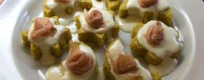 Crostini di polenta con crema di stracchino e speck