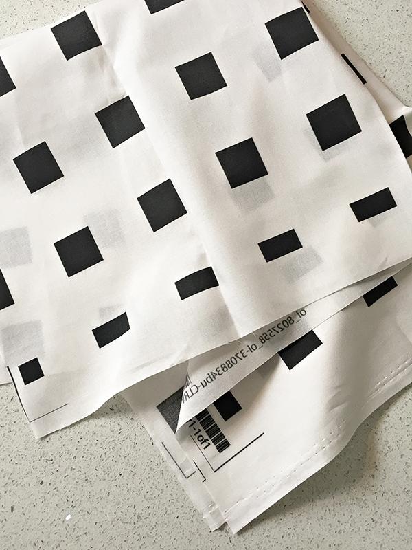 Friday Favorites  black squares pattern on white fabric