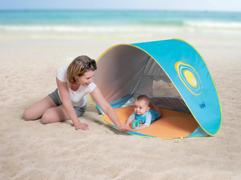 09858fa92583 10 consejos para un día divertido y seguro en la playa con tu bebé