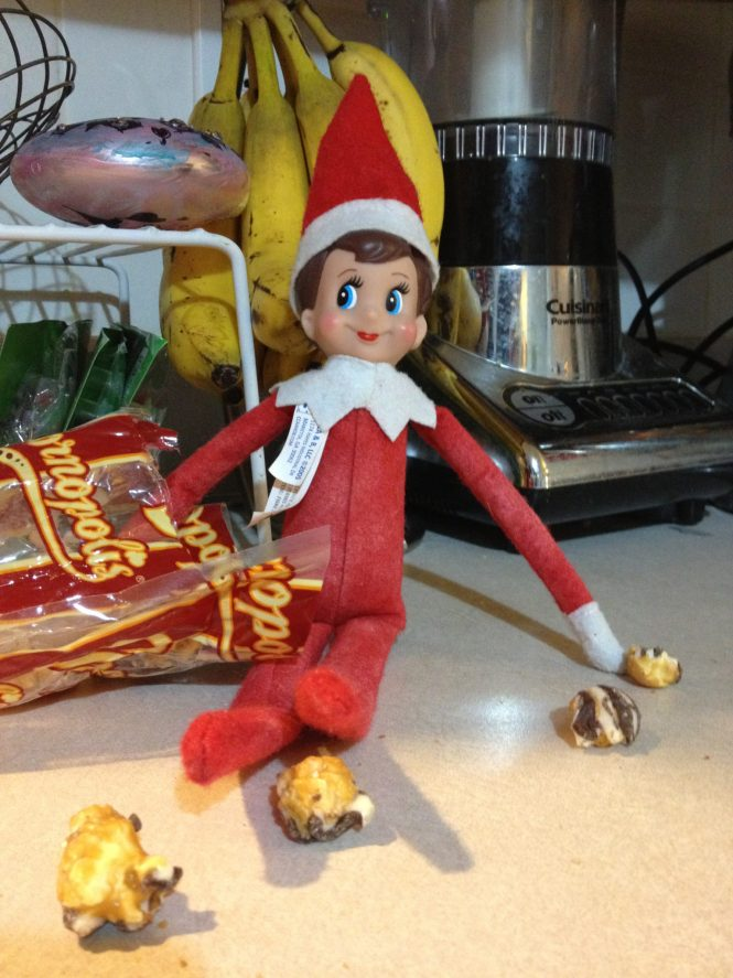 elf on the shelf eats popcorn