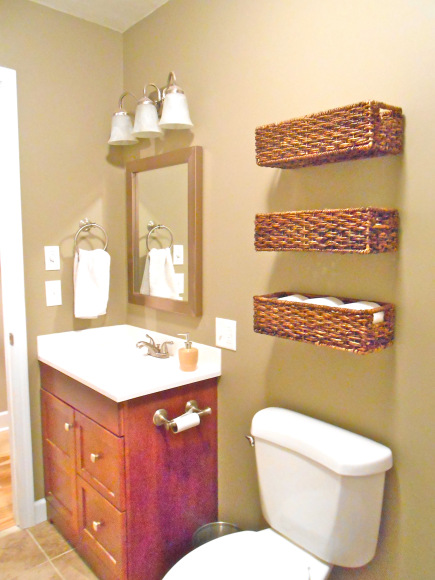 bathroom organization: wicker baskets on wall
