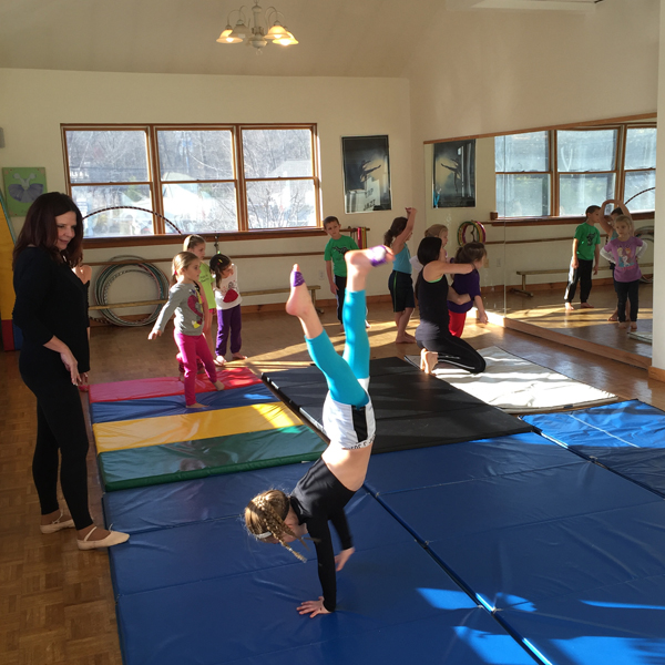 Pajama Program fundraiser | practicing hand stands