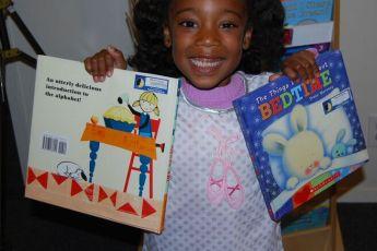 Pajama Program | child with books