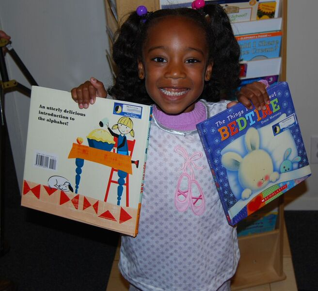 Pajama Program | child with books