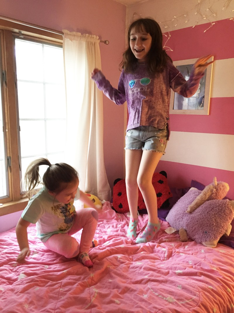 jumping on the bed in LittleMissMatched spring fashion