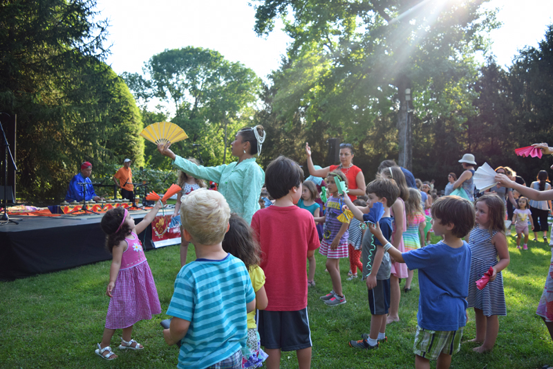 Westchester family fun learning Filipino dance moves at Caramoor