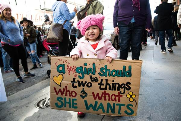 Best Women's March Signs | a girl should be two things who and what she wants via NBC News