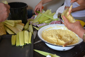 packing the husks with the corn meal.