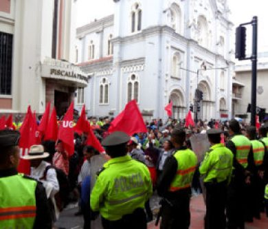 Protestors march on Simon Bolivar as police guard the mayor's office,